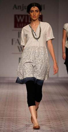 notable: loose tunic; great necklace; cropped pant and flats.
