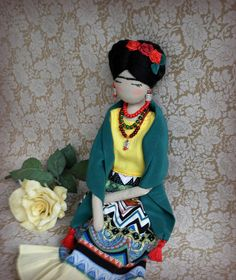 Frida Kahlo in bright juicy colors. All of her accessories are made by hands. The shawl is removable. Her face is embroidered, hair is felted from wool. This doll is unique, made with love and care, and has many beautiful details. It may become a wonderful gift for you or your loved one. Height is about 35 cm / 14 inches. Do not wash, wipe clean only! If you like Frida, see also other dolls in my shop. Thank you so much for viewing my art))