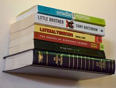 "Tutorial for making an ""invisible"" bookshelf by upcycling a hardcover book."