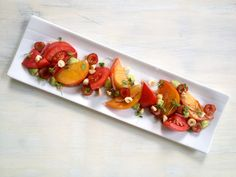 Heirloom Tomato Salad with Sour Cherries, Hazelnuts, Gingered Balsamic Vinaigrette, Lemon Basil, and Whipped Avocado Creme | Downtown Epicure