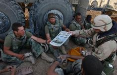 """Command Sgt. Maj. John Sparks delivers copies of """"Stars and Stripes"""" to Marines from Weapons Platoon, 3-2 India Company. Sparks also talked with the Marines about problems they've encountered with their gear. The Marines are part of Task Force Tarawa, which is spending a little 'down time' after the battle of An Nasiriyah where it set up blocking positions, searched houses and enemy prisoners of war. (Army photo/Sgt. 1st Class David K. Dismukes)  Read more: http://dvidshub.net/r/2l2dzb"""