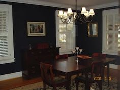 Navy dining room with shutters
