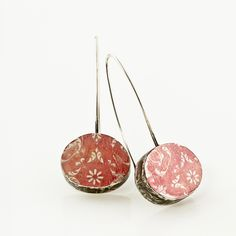 CAROLINE BASSETT-NZ These oxidised sterling silver drop earrings have a soft red/rose luminescence and a nostalgic feel to them.