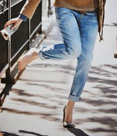 Bow stilettos with boyfriend jeans and red pedicure