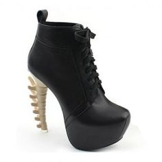 It almost looks like a spine!  0.o Stylish Women's Boots With Lace-Up and Strange Style Heel Design