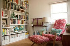 great chair, globes, lamp, magazines on bottom shelf