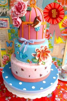 What a magnificent cake! I love the colours.. (winning cake design in the PIP cake decorating contest by Claudia from Albiate (MB) Italy)