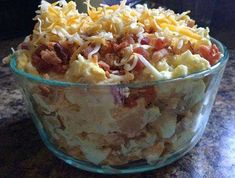 Ingredients   8 medium Russet Potatoes 1 cup sour cream 1/2 cup mayonnaise 1 package of bacon, cooked and crumbled 1 small onion, chopped Chives, to taste 1 1/2 cups shredded cheddar cheese ...
