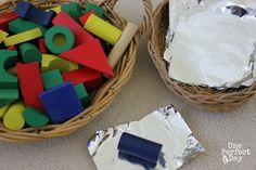 Blocks with foil open ended play - a simple invitation to play with blocks and kitchen foil. So many possibilities and great for a wide range of ages too. Love this!