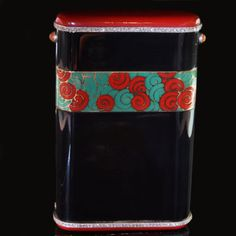 Beautiful and rare cigarette case of rectangular form with a sprung opening and coral cabochon push-piece in platinum and black onyx with a stylised scroll design panel and red enamel terminals each with a diamond trim Cartier, Paris circa 1925
