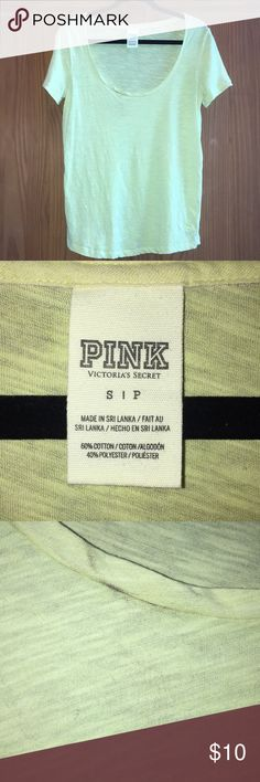 PINK Tee Brand: PINK Condition: Used/Great condition. Worn it a couple times. Has been washed. My dryer made a black mark on the front as pictured & I just haven't worn it. 🚭 Size: S Color: Yellow Green 🚫No Trades 🚫No Lowball Offers 🚫No Rude Comments  🚫No Modeling  ⚠️Please don't discuss prices in the comment box. Make a reasonable offer and I'll either counter, accept or decline. PINK Victoria's Secret Tops Tees - Short Sleeve