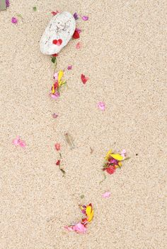 Remnants of an offering on the beach in Bali