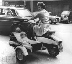 1960's Lambretta with a baby side car. Detachable of course!