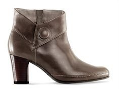 Low-Heeled Clarks -Smart features like covered buttons and cuffs make a sporty low-heel boot the ideal partner for jeans and a blazer.