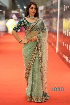 Net Saree Green color saree with over all work and heavy embroidery lace with embroidery work blouse Sari indian Couture Fancy Blouse Designs, Saree Blouse Designs, Bollywood Saree, Indian Designer Outfits, Indian Outfits, Saris Indios, Sari Bluse, Saree Trends, Wedding Hairstyles