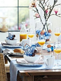 Fresh colors for Easter - blue and white table setting, vase filled with painted eggs