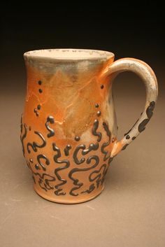 Soda Swirl Mug at $25.00.    Handthrown white stoneware mug with a black slip swirl deoration. Fired to cone 10 in a soda reduction kiln. Food and dishwasher safe.