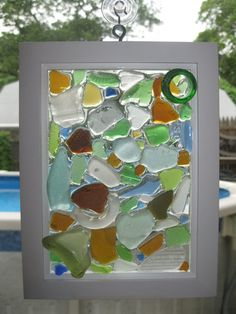 Sea glass. I think I could figure out how to do this. Would love to make one.