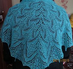 1 Shawl is knitted top down from neck to bottom, has a triangular shape and a central fragment.