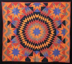 Dynamic vintage star quilt in cheddar, red and blue: One of more than 950 quilts Chappaqua residents Robert and Ardis James donated to the University of Nebraska-Lincoln.