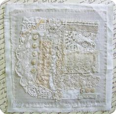 Beautiful use of vintage lace and buttons on this white on white sampler