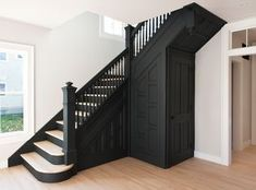 historic stair painted black in modern renovation of turn-of-the-century Hudson Valley home renovation Staircase Black Staircase, Wood Staircase, Staircase Design, Grand Staircase, Black Banister, Black Painted Stairs, Stair Banister, Railings, Painted Staircases