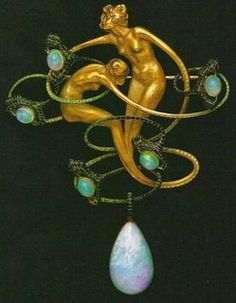 A delicate Lalique brooch in the form of two entwined gold woman and a thin thread of emeralds with opal adornments.