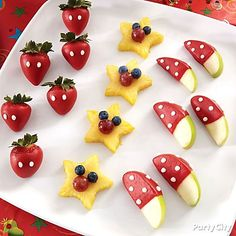 Get ready to dip! Create Mickey mouse inspired dipped-fruit by adding smiley faces with berries and a few signature white polka-dots!