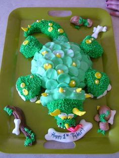 A cute Dinosaur cake I made for my son. Fondant, buttercream pipping, hand painted, sculpted. 2008
