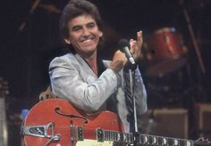 """George Harrison at the Carl Perkins """"A Rockabilly Session"""" special, 21 October 1985. Photo: Dave Hogan """"You know, I've always wanted one of them orange Gretsches with a big 'G' stamped on it. I finally got one - my wife got me the one I used on the Carl Perkins program for Christmas a couple of years ago - except it didn't have a 'G' on it."""" - George Harrison, Guitar Player, November 1987"""