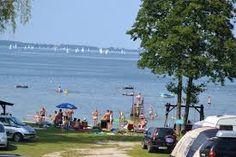 Znalezione obrazy dla zapytania pole namiotowe nad jeziorem na mazurach giżycko polska