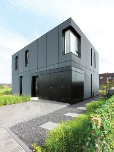 """perforated and expanded aluminum facade. While still studying architecture at Eindhoven University, Servie Boetzkes and Jeroen Helder landed a commission through """"friends of friends"""" to build a home in a suburb of Arnhem."""
