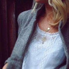Lovely contrast of heavy tweed jacket, lace detail delicate blouse & layered necklaces