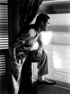wehadfacesthen: Cary Grant at his Malibu beach house on a rainy afternoon, 1934 (via kikisloane) Hollywood Actor, Classic Hollywood, Old Hollywood, Hollywood Icons, Hollywood Glamour, Hollywood Stars, Hooray For Hollywood, Golden Age Of Hollywood, Malibu Beach House