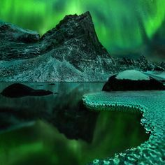 """The Aurora Borealis (Northern Lights) & the Aurora Australis (Southern Lights) are brilliant light shows in the earth's atmosphere. The auroras occur when highly charged electrons from the solar wind interact with elements in the earth's atmosphere. Solar winds stream away from the sun at speeds of about 1 million miles per hour. When they reach the earth, they follow the lines of magnetic force generated by the earth's core and flow through the magnetosphere. """"Green Vision"""" by Marc Adamus"""