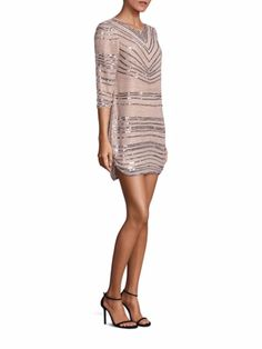 Blush sequined bridesmaid dress: Sequins are a fun way to add some pizzazz to bridesmaid dresses, however they can get quite warm when sequined dresses have long sleeves. Choose a more toned down version, like this classy three-quarter sleeve tunic style dress with silver sequin detailing. | Short and Sparkly Bridesmaid Dresses
