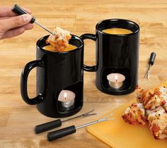 $15 Fondue mugs! Easy fondue at home! Melt cheese or chocolate for dipping fruit, veggies, breads and more. Ceramic mugs feature bottom openings for tea lights to heat your favorite dip. Set of 2 mugs and 4 dipping forks.Microwave and dishwasher safe.
