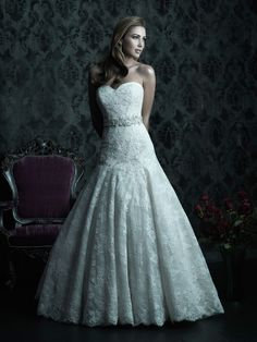 Soft and romantic. This lovely fitted A-line, ball gown features lace applique on English net over an all-over lace to create dimension.  It is completed with a sweetheart neckline and chapel length train. Style C228