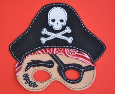 Love the Day has a hand-sewn party goods store to go with their awesome printables?!  Get out!!  :)  {$6 PDF pattern for DIY felt pirate mask}