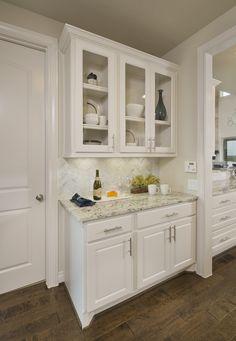 Cross Creek Ranch Model Home Open Daily - 4,098 Sq. Ft. - Butler's Pantry - #PerryHomes #trustedbuilder #homebuying #homebuilding #CrossCreekRanch #FulshearTX #KatyISD #KatyHomes #KatyTX #HoustonHomes #openconcept #openfloorplan #familyhome #realestate #RelocatingtoHouston #lakesidecommunity #lakesideliving #landscaping #brickexterior #stoneexterior #cabinets #butlerspantry #pantry #whitekitchen #countertops #hardwoodflooring