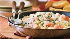 Shrimp Scampi - Quick-Fix Entrées for Entertaining - Southern Living - Recipe: Shrimp Scampi  Lemon and garlic combine with delicate angel hair pasta and mild-flavored shrimp for a refreshing and quick pasta supper. Buy peeled and deveined shrimp at the grocery store to cut prep time.