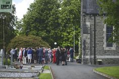 Guests gather outside the church after the ceremony to mingle. Weddings at Cabra Castle photographed by Couple Photography. Glenda, Love At First Sight, Couple Photography, The Outsiders, Castle, Street View, Weddings, Couples, Things To Sell