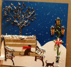 I am not quite ready to say good-bye to snow and the holidays. The card I prepared for you today is more of a winter card with a skosh of holiday with a small poinsettia. Supplies you will need: 902 Small Blooming Poinsettia 893 Village Lamp Post 859 Walking Cat - small 872 Curious Cat 891 Madison Park Bench 961 Trailing Vine 901 Viva Tree 909 Birthday Candles 945 Woodland Fawn (scarf only) Adhesives Snow (glitter, flocking, etc.) Chalk ink Q-tips Cardstock I created this as a 5 1/2