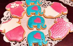 Baby Girl shower onesie decorated cookies and elephants to match invite theme party.