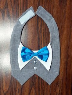 Beautiful Heather Gray Tuxedo Vest for XS - XL Dogs. Made of high quality suiting fabric. Many different colors of satin bow ties to choose from, or supply your own fabric for a perfect match to your wedding colors. The perfect way to dress your dog in formal attire yet leave him the freedom and roominess to run and play. Ideal for dogs who arent used to wearing clothes or who typically dont like to wear clothes.
