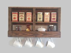 Rustic Wooden Coffee and Tea Rack, Coffee Bar, Pallet Furniture, Pallet Rack, Pallet Shelf, Rustic Kitchen Rack, Reclaimed Wood Shelf by DunnRusticDesigns on Etsy https://www.etsy.com/listing/186743052/rustic-wooden-coffee-and-tea-rack-coffee