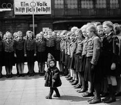 Girls of the German Girls League (BDM) have met in Dresden for a fund raising of the Winter Relief of the German people (WHW) under the motto 'a nation helps itself!'. Date of picture unknown.