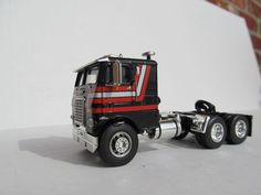 DCP 1/64 SCALE FREIGHT LINER CABOVER BLACK WITH RED AND GRAY STRIPES