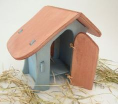 Beautiful handmade wooden hen house from traditional toymaker Ostheimer - and at Cottontails we also include two Ostheimer wooden grass pieces and a little bag of hay ready to make your hen house cosy!  As with all Ostheimer toys, the hen house has been hand made and hand painted, using ethically sourced wood and safe water based paints.