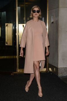 Rosamund Pike in a Louis Vuitton dress, Marni leather coat and Marni leather ankle-strap pumps